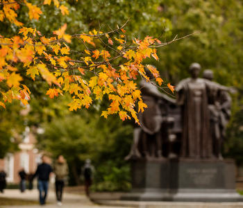 alma mater statue in fall